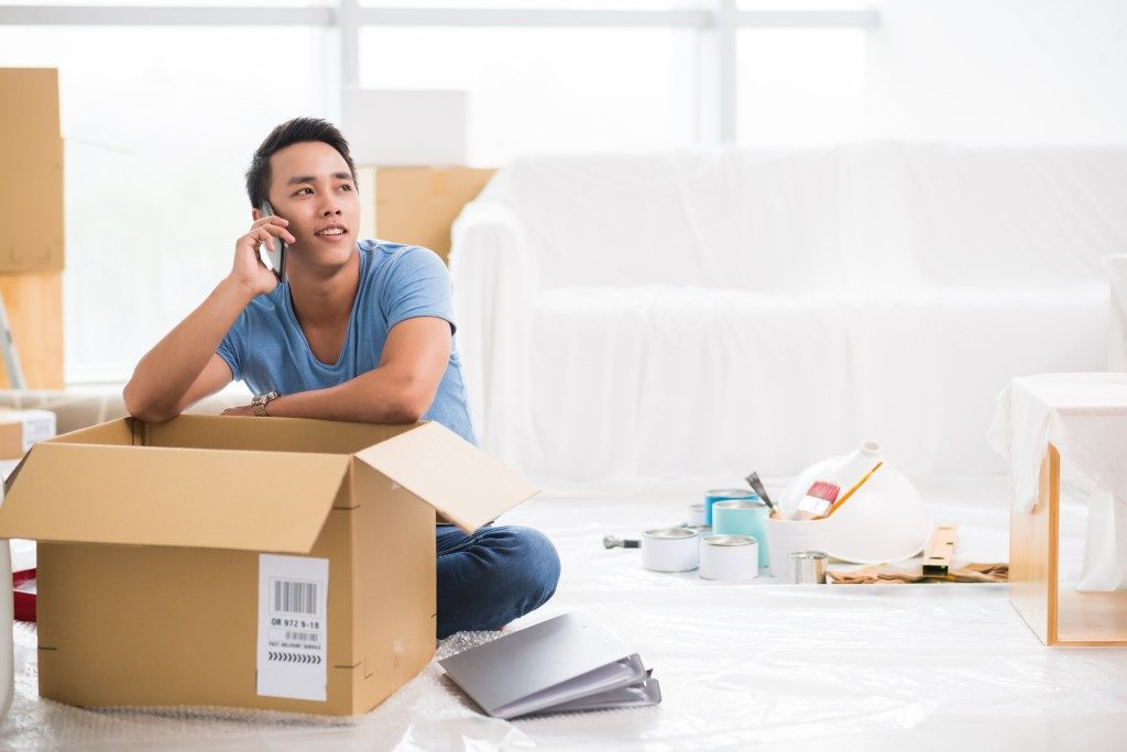 man who just moved in using phone
