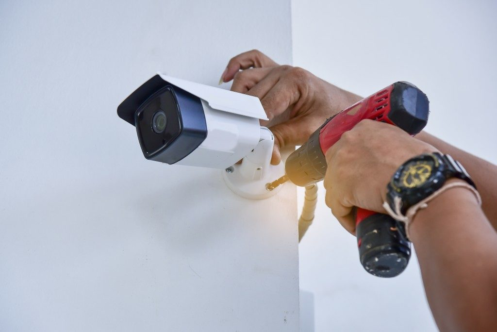 person installing a cctv
