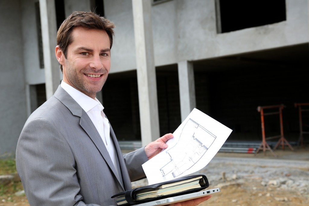 Businessman checking a construction site