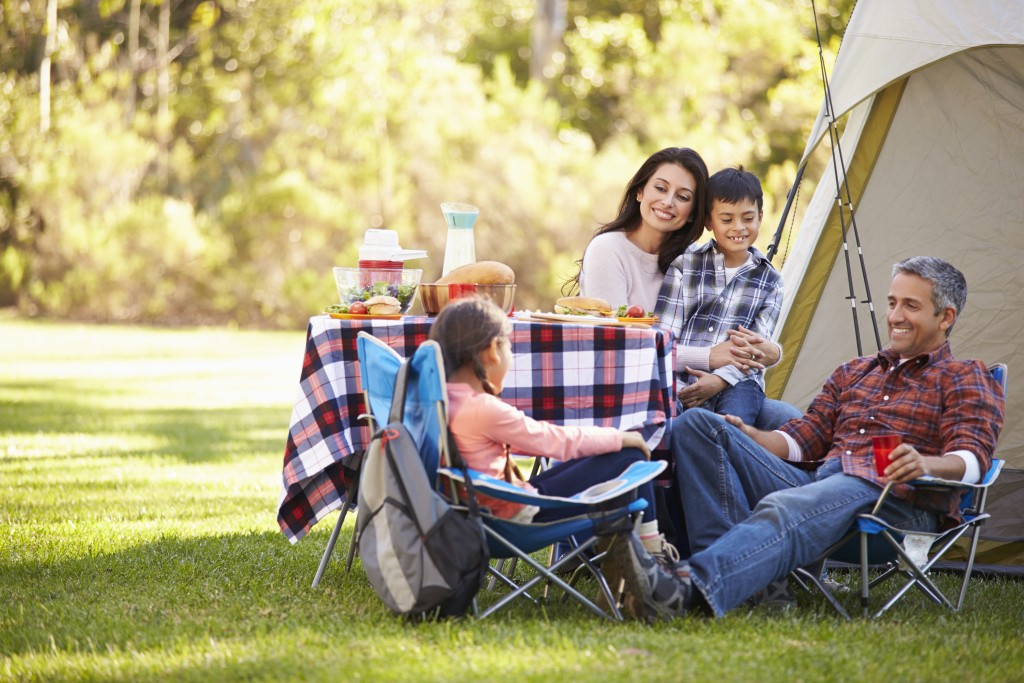 a family enjoying camping