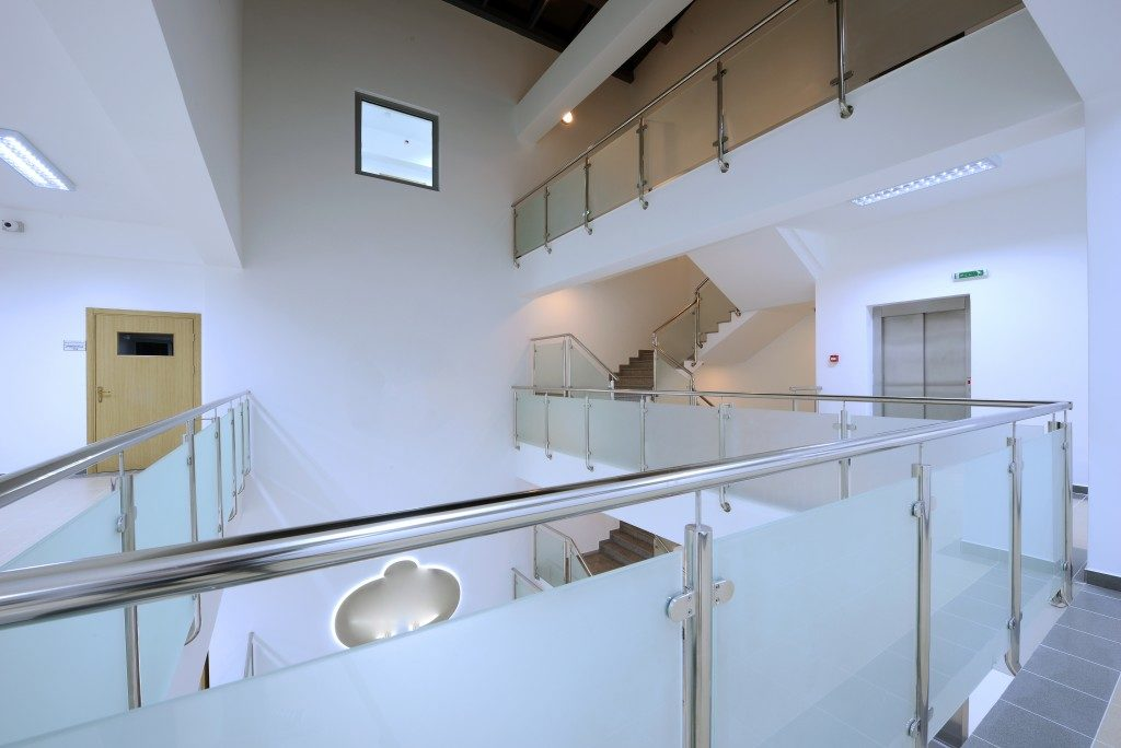Modern staircase and hall with glass banister