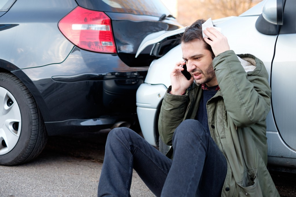 frustrated man in a car accident