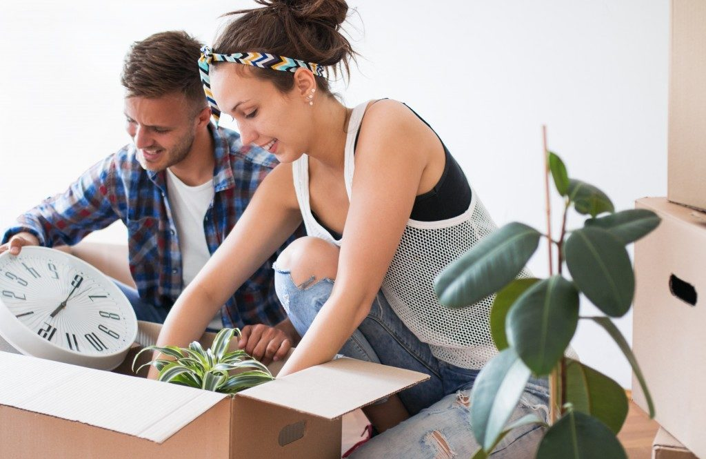 Man and woman packing a box